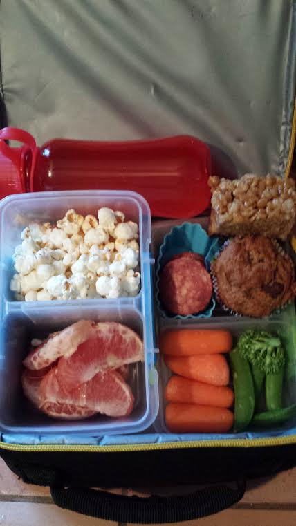 Homemade GF banana muffin, Open Nature Hot Uncured Salami slices, Budda Bowl Himalayan Sweetness popcorn, grapefruit, peas, broccoli, carrots. Dessert: Seedbutter Krispy Scotcheroo